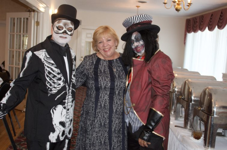 Photo Provided From left, Dr. Naba Goswami, president of the Belmont County Medical Society, Marlene Henderson of the American Red Cross and Dr. Rene Dela Cruz, event co-organizer, pose during the festivities at a costume party fundraiser for victims of Hurricanes Harvey and Irma. The event took place at the Belmont County Country Club in St. Clairsville on Oct. 19.