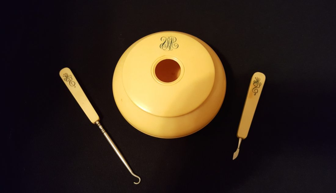 Photo Provided Hair receivers, like this celluloid version, are an odd bit of social history and were used by Victorian women who saved hair for use in pin cushions, pillows and hair ratts. It is shown with an antique button hook and a delicate razor, all part of a dresser set.