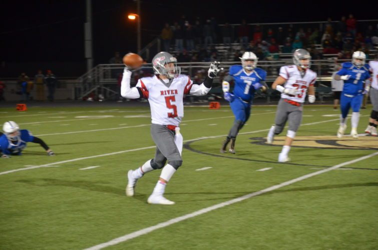 Photo by Rick Thorp River quarterback Lukas Isaly looks to throw during Friday's playoff victory.
