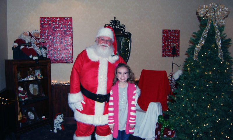 Photo Provided Santa Claus greets Jana Lu Schodzinski at the 2016 Ho-Ho-Hope for a Cure. This year's event will be held from 9 a.m. to noon on Saturday at River City Restaurant in Wheeling. Proceeds benefit the Juvenile Diabetes Research Foundation's Search for a Cure.