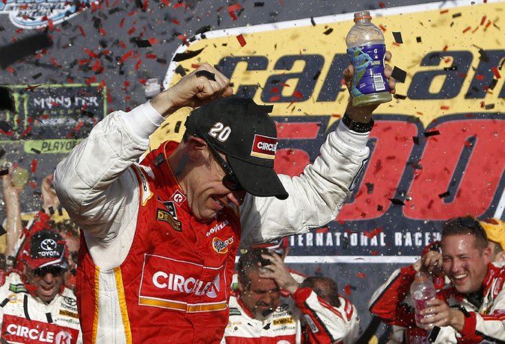 Matt Kenseth celebrates his win in Victory Lane after a NASCAR Cup Series auto race at Phoenix International Raceway Sunday, Nov. 12, 2017, in Avondale, Ariz. (AP Photo/Ross D. Franklin)