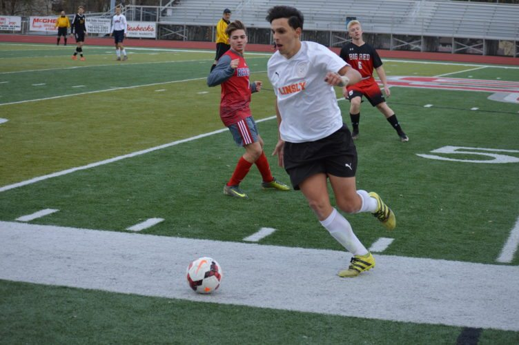 Photo by Cody Tomer Linsly's Manuel Suita pushes the ball down the sideline with St. Clairsville's Kyle Hendershot defending during the OVAC All-Star Game on Sunday at St. Clairsville.
