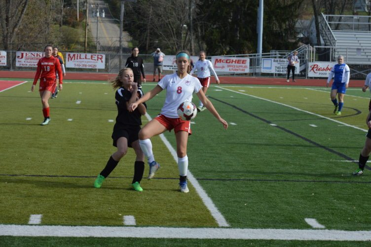 Photo by Cody Tomer Wheeling Park's Lauren Schultz corals the ball during Sunday's OVAC All Star Game at St. Clairsville, while Monroe Central's Jacquelyn Hayes defends.