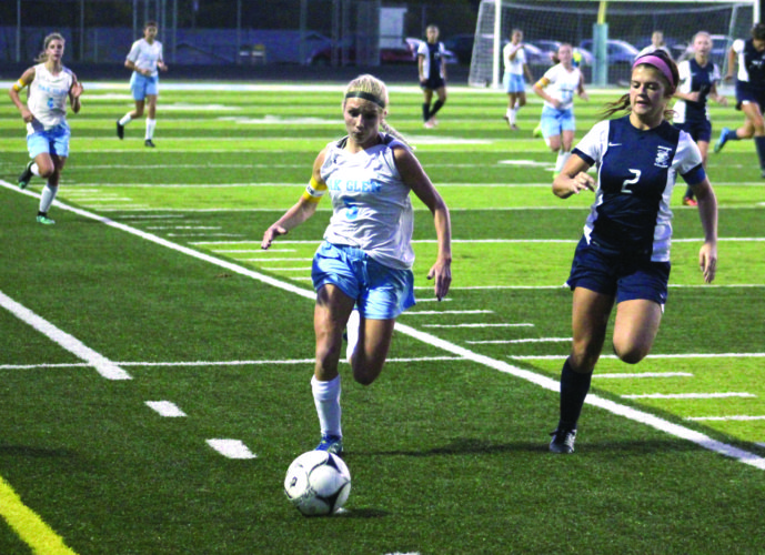 Photo by Joe Catullo Oak Glen's Maggie Kovalcik (5) was named First Team all-state by the West Virginia Sports Writers Association.
