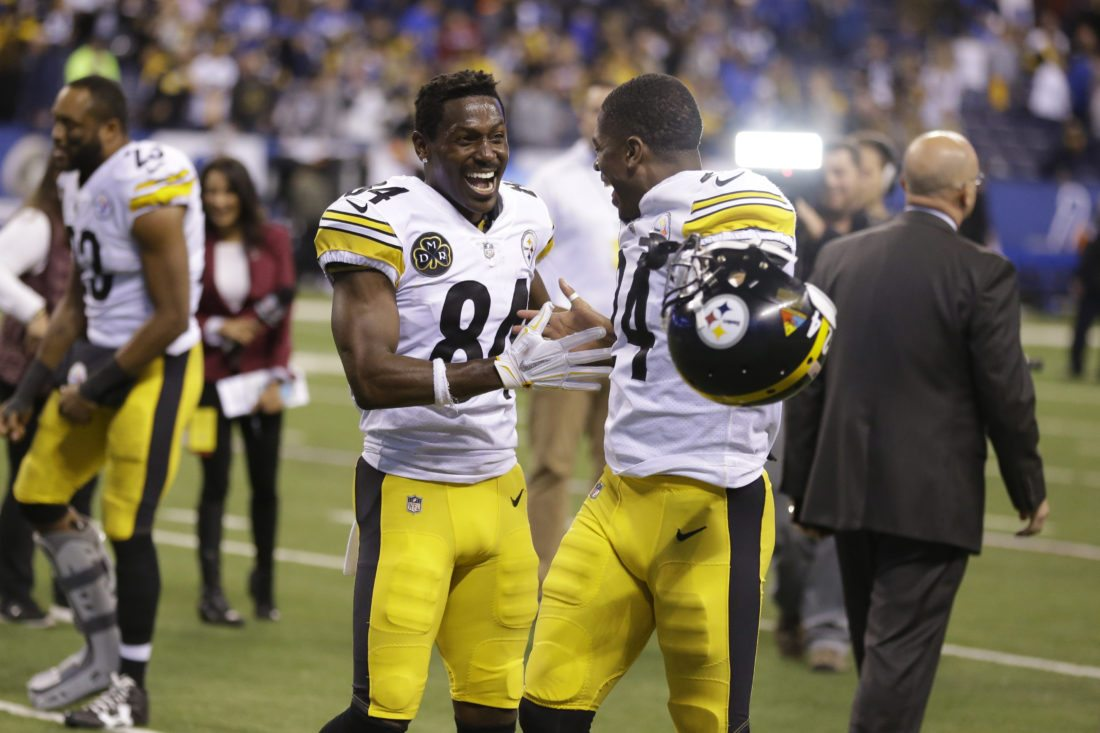 Pittsburgh Steelers wide receiver Antonio Brown (84) and defensive back Coty Sensabaugh (24) celebrate as they leave the field following an NFL football game in Indianapolis, Sunday, Nov. 12, 2017. The Steelers defeated the Colts 20-17. (AP Photo/Michael Conroy)