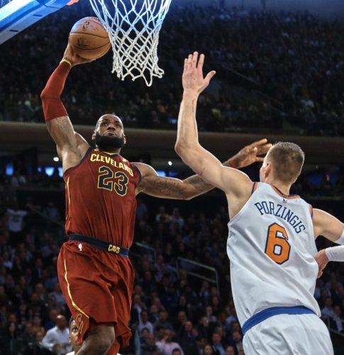 Cleveland Cavaliers' LeBron James, left, drives to the basket against New York Knicks' Kristaps Porzingis (6) during the first half of a NBA basketball game at Madison Square Garden in New York, Monday, Nov. 13, 2017. (AP Photo/Andres Kudacki)
