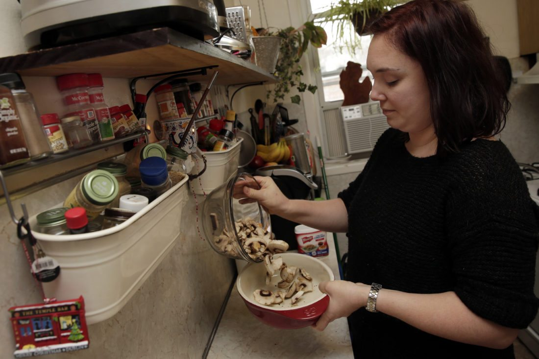 Ruthy Kirwan, of Percolate Kitchen, puts a layer of fresh sliced mushrooms in a gratin dish as she prepares her version of the classic Thanksgiving favorite Green Been Casserole, in her apartment kitchen in the Queens borough of New York, Wednesday, Nov. 8, 2017. Before actors perform a play for an audience, they run a dress rehearsal to look for kinks that need fixing before the show opens. Traditional Thanksgiving dinner is a big production that can benefit from rehearsal, too, say some veteran hosts. (AP Photo/Richard Drew)