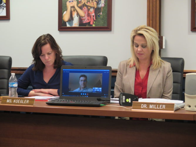 Photo by Joselyn King Ohio County Board of Education member Sarah Koegler, left, and Superintendent Kim Miller preside over Tuesday's school board meeting as board president Zach Abraham participates through teleconferencing.