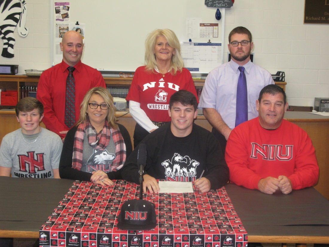 Photo by Bubba Kapral Martins Ferry standout wrestler Dalton Hoover signs his National Letter of Intent Tuesday with Northern Illinois University. Hoover is flanked by his brother Trey, mother Robyn, Hoover, and father Jim. Back row is Martins Ferry High Principal Joe Mamone, Athletics Director Kim Appolloni and Coach Chaz Yoder.