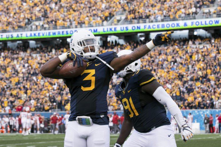 West Virginia's Al-Rasheed Benton (3) celebrates following an interception during the first half of an NCAA college football game against Iowa State in Morgantown, W. Va., Saturday, Nov. 4, 2017. (AP Photo/Walter Scriptunas II)