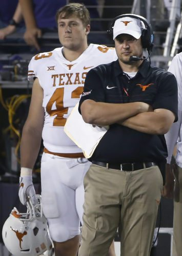 Texas coach Tom Herman and tight end Robert Willis (43) watch from the sideline as Texas plays TCU during the second half of an NCAA college football game Saturday, Nov. 4, 2017, in Fort Worth, Texas. TCU won 24-7. (AP Photo/Ron Jenkins)