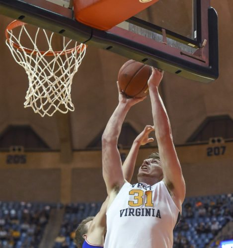 West Virginia's Logan Routt shoots against American during an NCAA college basketball game Wednesday, Nov. 15, 2017, in Morgantown, W.Va. (William Wotring/The Dominion-Post via AP)