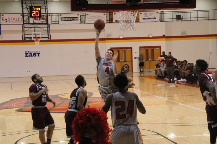 Photo Provided by Wheeling Jesuit Wheeling Jesuit's Preston Boswell (4) floats a shot toward the basket during Wednesday's victory against Virginia Union.