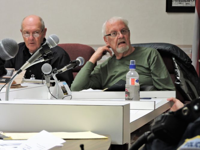 Photo by Shelley Hanson Bellaire Village Clerk Tom Sable, left, and Councilman James Piatt listen during village council's meeting Thursday.