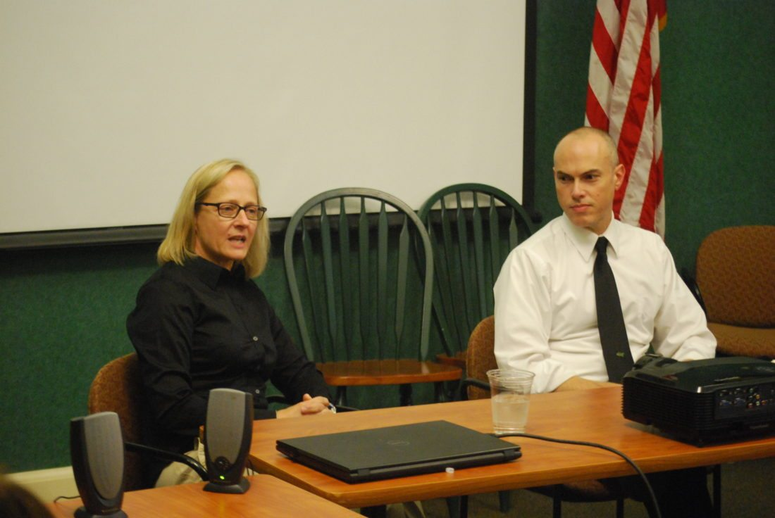 Photo by Alec Berry Huntington Fire Chief Jan Rader, left, and Wheeling Jesuit University professor Dan Weimer participate in a panel discussion on the area's opioid addiction crisis Thursday at the First State Capitol in Wheeling.