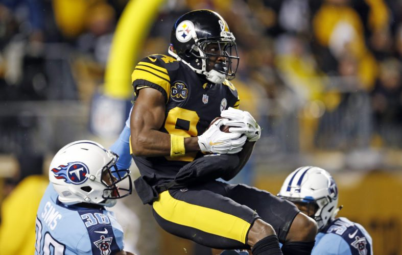 Pittsburgh Steelers wide receiver Antonio Brown (84) catches a pass from quarterback Ben Roethlisberger for a touchdown with Tennessee Titans cornerback LeShaun Sims (36) defending during the first half of an NFL football game in Pittsburgh, Thursday, Nov. 16, 2017. (AP Photo/Keith Srakocic)