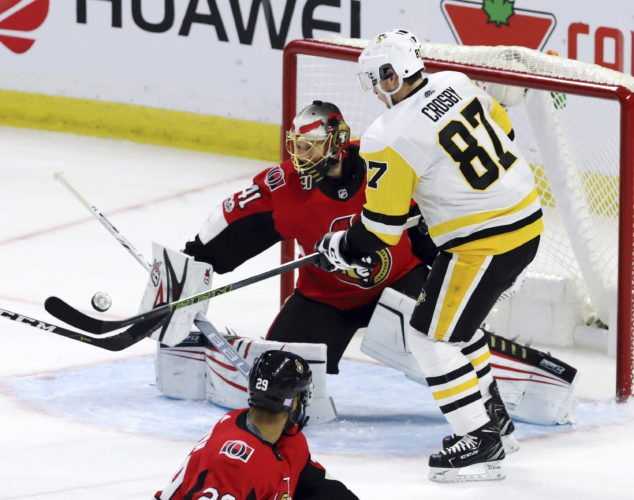 Pittsburgh Penguins center Sidney Crosby (87) tries to tip a puck in front of Ottawa Senators goalie Craig Anderson (41) during first period NHL hockey action, in Ottawa on Thursday, Nov. 16, 2017. (Fred Chartrand/The Canadian Press via AP)