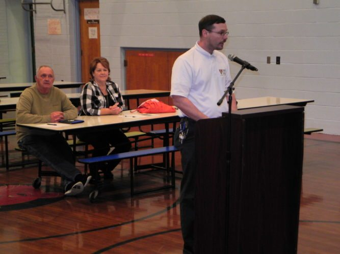 Photo by Warren Scott Beech Bottom Councilman Greg Sheperd questions Brooke County Schools officials during a public hearing Thursday at Beech Bottom Primary School.