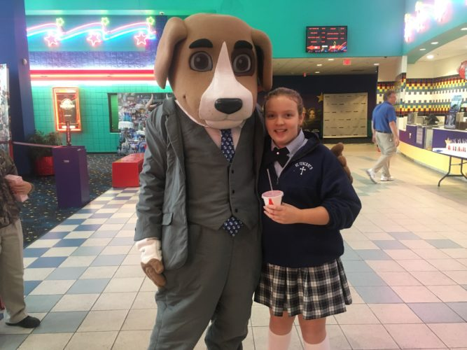 "Angelina Robrecht, a fifth-grader at St. Vincent de Paul Parish School, visits ""Justice,"" the Bordas & Bordas law firm mascot, before viewing the movie ""Wonder"" at Marquee Cinemas at The Highlands Friday morning."