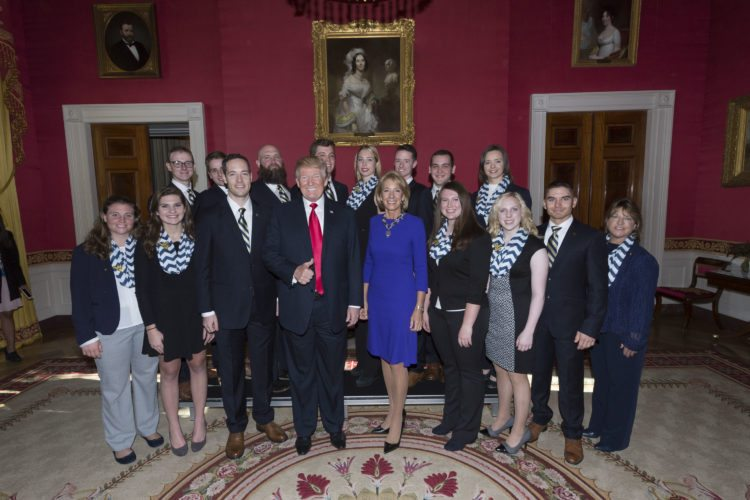 Official White House Photo by Andrea Hanks President Donald Trump meets and poses for photos with the West Virginia University NCAA National Championship Rifle Team on Friday during the Collegiate National Champions Day in the Red Room at the White House in Washington, D.C.