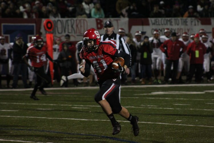 Photo by Joe Catullo Steubenville's Eric Lulla returns an interception for a touchdown during Friday's game.