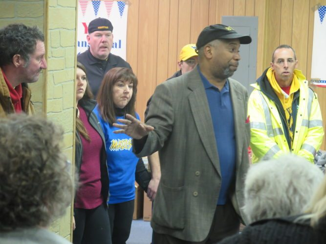 The Rev. Darrell Cummings of the  Bethlehem Apostolic Church speaks to volunteers Saturday. Photo by  Alec Berry