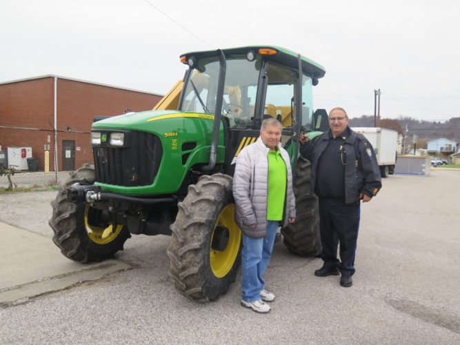 Photo by Joselyn King Benwood Mayor Ed Kuca, left, and Police Chief Frank Longwell examine the city's new John Deere tractor.