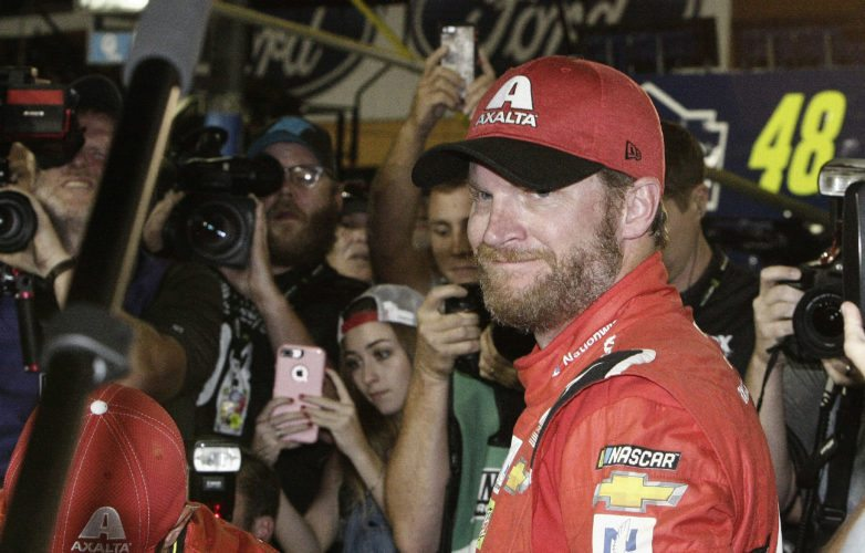 Dale Earnhardt Jr. is surrounded upon getting out of his car after a NASCAR Cup Series auto race at Homestead-Miami Speedway in Homestead, Fla., Sunday, Nov. 19, 2017. Earnhardt is retiring from full-time racing. (AP Photo/Terry Renna)