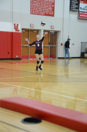 heeling Central's Julie Padden serves during the OVAC All-Star volleyball game on Sunday  Photo by Kim North