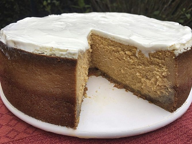"This Oct. 16, 2017 photo shows a Pumpkin Cheesecake with Crystallized Ginger Crust. This recipe is adapted from Natalie Dupree's companion cookbook ""Nathalie Dupree Cooks for Family and Friends"" to her PBS show, ""Food for Family and Friends,"" published in 1991. (AP Photo/Elizabeth Karmel)"