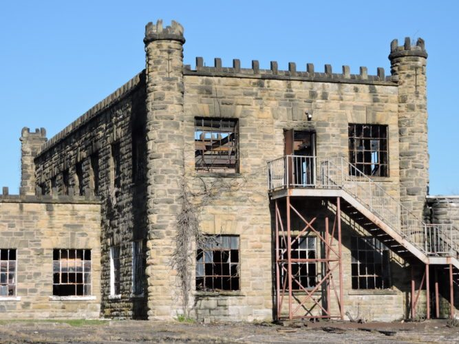 Photo by Casey Junkins The burned structure near the former West Virginia Penitentiary had sat vacant for years, disconnected from the grid, before Monday morning's fire gutted the second floor.
