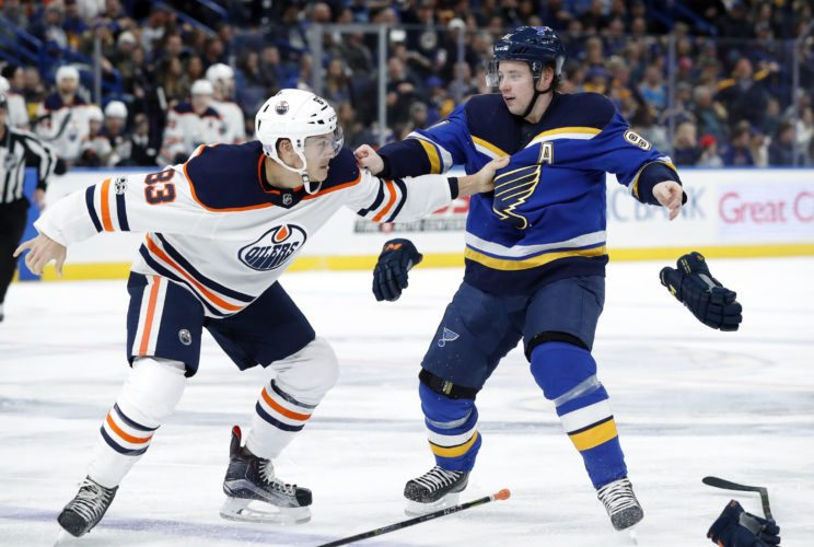 Edmonton Oilers' Matt Benning, left, and St. Louis Blues' Vladimir Tarasenko, of Russia, fight during the second period of an NHL hockey game Tuesday, Nov. 21, 2017, in St. Louis. (AP Photo/Jeff Roberson)