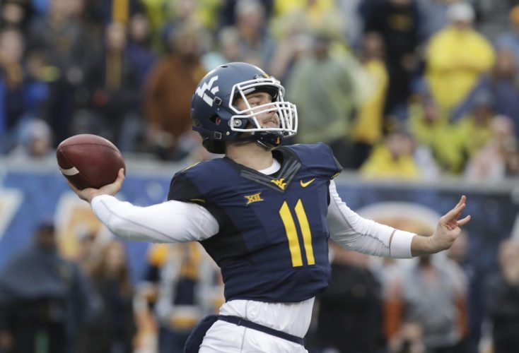 West Virginia quarterback Chris Chugunov (11) attempts a pass during the second half of an NCAA college football game against Texas, Saturday, Nov. 18, 2017, in Morgantown, W.Va. Texas defeated West Virginia 28-14. (AP Photo/Raymond Thompson)