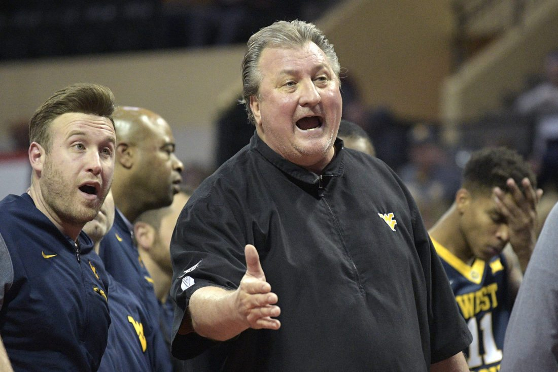 West Virginia head coach Bob Huggins, front right, argues a call during the second half of an NCAA college basketball game against Marist at the AdvoCare Invitational tournament Thursday, Nov. 23, 2017, in Lake Buena Vista, Fla. (AP Photo/Phelan M. Ebenhack)