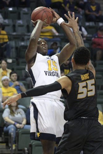 West Virginia forward Lamont West (15) goes up for a shot in front of Missouri guard Blake Harris (55) during the first half of an NCAA college basketball championship game at the AdvoCare Invitational tournament Sunday, Nov. 26, 2017, in Lake Buena Vista, Fla. (AP Photo/Phelan M. Ebenhack)
