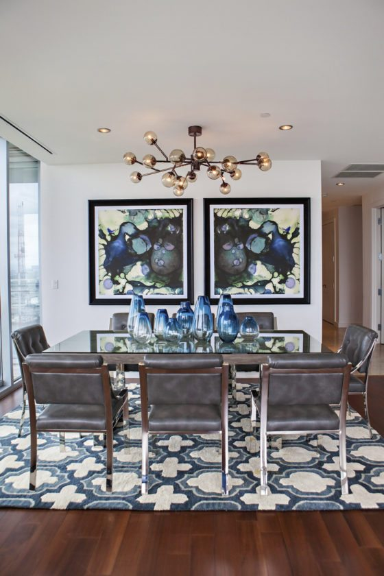 This undated photo provided by designer Abbe Fenimore shows a dining room designed Fenimore. Comfort is just as important as beauty when choosing dining room seating, says Fenimore, founder of the design firm Studio Ten 25, who chose sleek but softly padded chairs for the dining room shown here. (Melanie Johnson/Abbe Fenimore via AP)