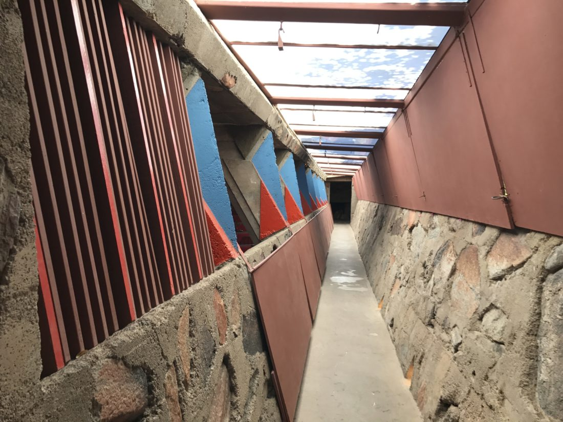 This Sept. 24, 2017 photo shows a passageway at Taliesin West in Scottsdale, Ariz., which served as the winter home of architect Frank Lloyd Wright. Built on the desert's hard floor, Wright constructed the structures with redwood beams and large rocks embedded in concrete. The buildings initially were covered with translucent canvas to let light in, but were later replaced with more durable plastic because of the sun's brutal rays. Windows were large openings without glass. (AP Photo/Anita Snow)