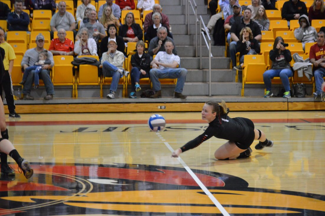 Photo by Cody Tomer Wheeling Jesuit's Stephanie Sylvester dives for a ball during Friday's regional semifinal match.