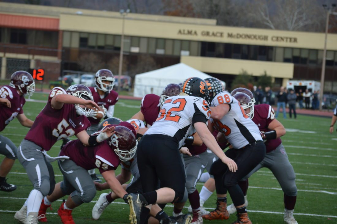The big guys up front, such as Luke Lawrence (52) and Luke  Duplaga (63) have opened a lot of holes for the Wheeling Central  rushing attack.   Photo by  Kyle Lutz