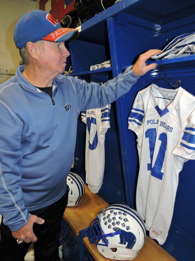 Photo by Casey Junkins Wheeling Park Patriots and Super Six equipment manager Sarge Cordery prepares a locker for the Polar Bears of Fairmont High School prior to the team's Friday game versus the Beavers of Bluefield High School.