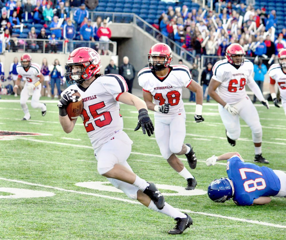 Photo by Michael D. McElwain Steubenville's Jacob Bernard runs for a big gain during the Division IV state championship game.