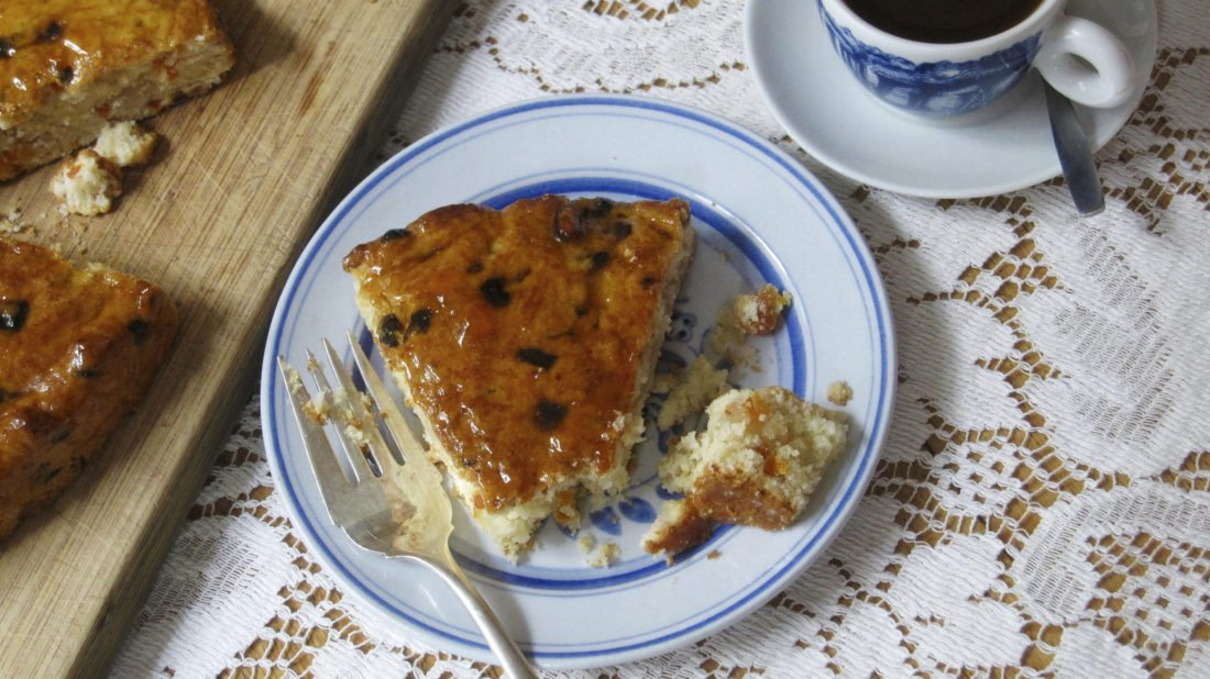 Apricot almond coffee cake is a special treat that features a cream biscuit dough packed with intensely flavored dried apricots, layered with almond paste and glazed with apricot jam. (Sara Moulton via AP)