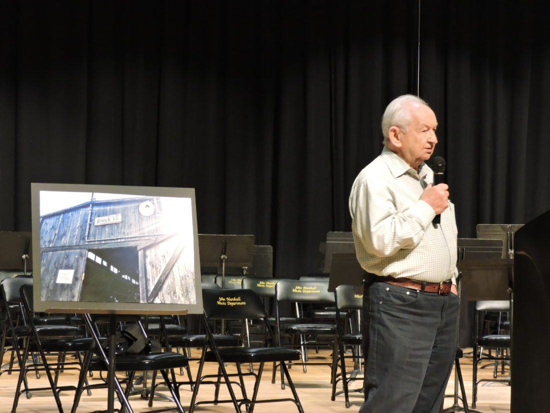 Photo by Alan Olson Holocaust survivor Howard Chandler shares his memories of surviving Nazi concentration camps during World War II while visiting John Marshall High School on Monday.