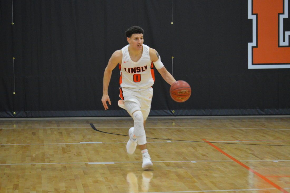 Photo by Kyle Lutz Linsly's Jimmy Zecca brings the ball down court during Tuesday's game against Fort Frye.