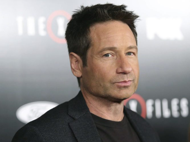 "In this Jan. 12, 2016 file photo, David Duchovny arrives at the season premiere of ""The X-Files"" at the California Science Center in Los Angeles, Calif. High-profile sex-related accusations against celebrities, politicians and media members have put a spotlight on sex addiction. Skeptics question whether it's a true addiction or a made-up condition used by misbehaving VIPs to deflect blame. Duchovny voluntarily sought rehab for sex addiction in 2008 while starring on Showtime's ""Californication.""  AP Photo"