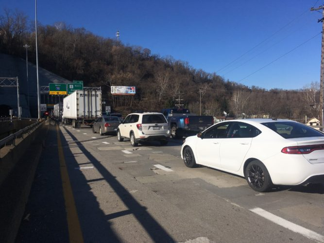 Photo by Jessica Broverman Vehicles traveling west on Interstate 70 are met with backed-up traffic Wednesday morning after a fire extinguisher believed to have fallen off a truck produced vapor inside the Wheeling Tunnel.