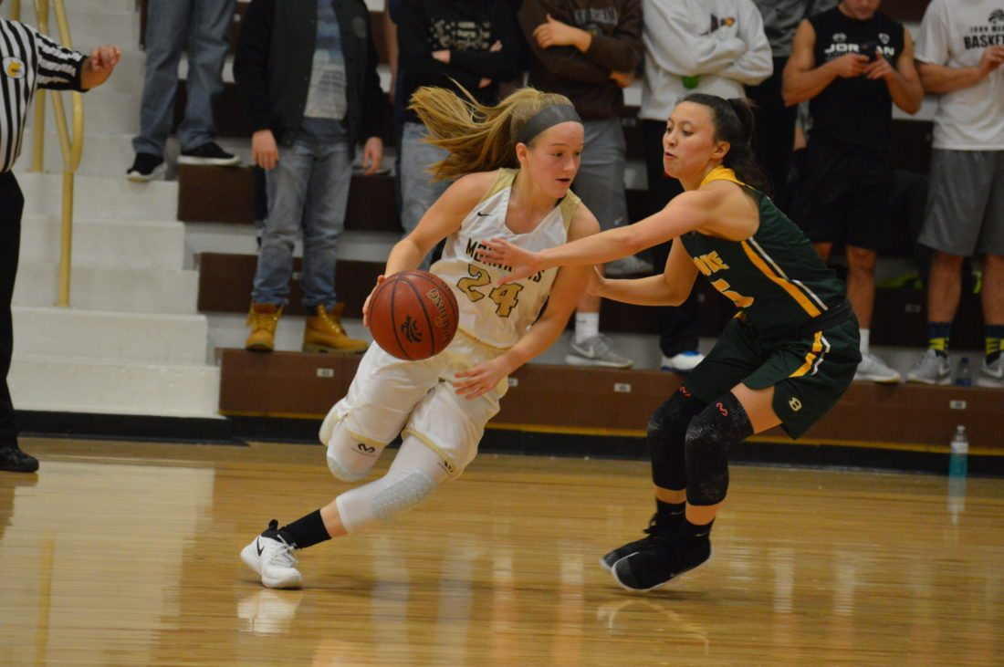 Photo by Cody Tomer John Marshall's Abby Blake (24) looks to get around Brooke defender Ashley Arca during Wednesday night's rivalry game at the Moundsville Fieldhouse.