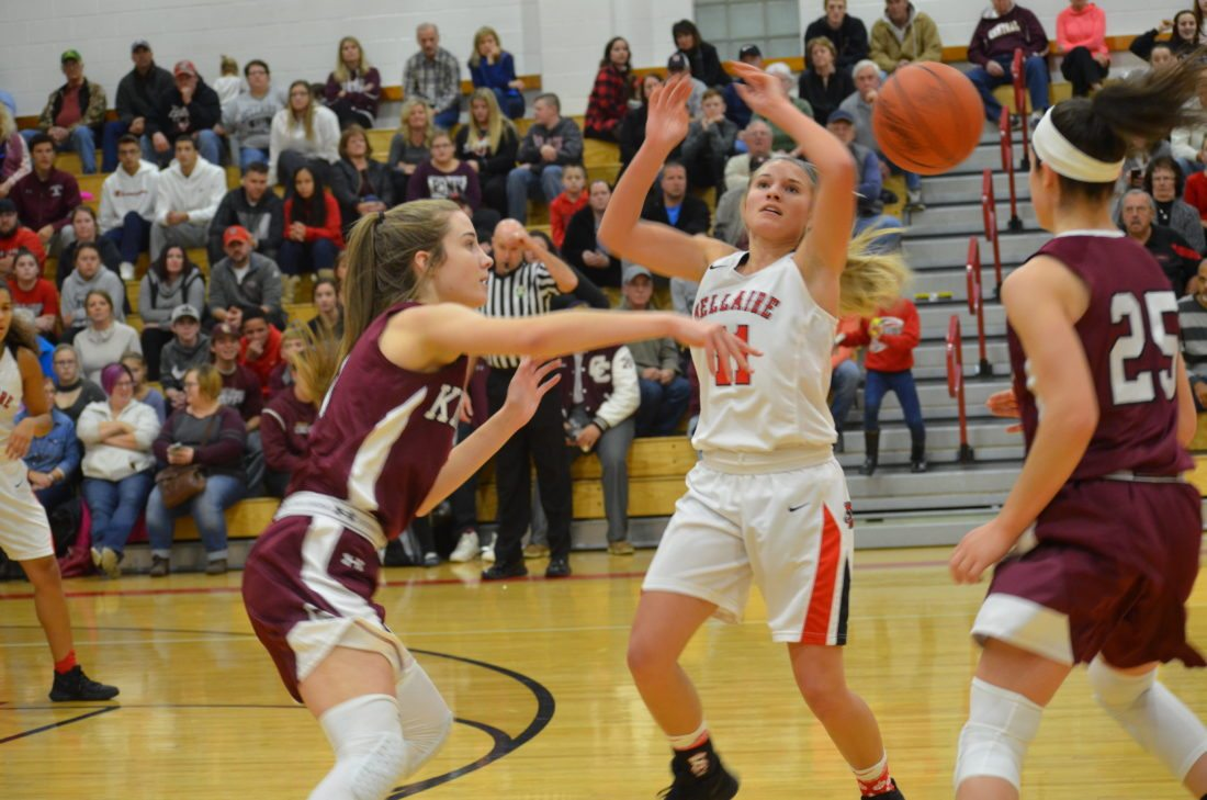 Photo by Rick Thorp Wheeling Central's Eden Gainer, left, knocks the ball from Bellaire's Natalie Stoner during their game Wednesday night in Bellaire.