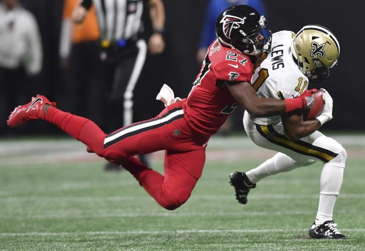 Atlanta Falcons free safety Damontae Kazee (27) tackles New Orleans Saints wide receiver Tommylee Lewis (11) during the first half of an NFL football game, Thursday, Dec. 7, 2017, in Atlanta. (AP Photo/Danny Karnik)