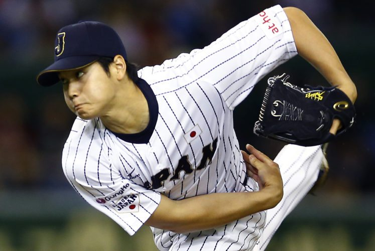 FILE - In this Nov. 19, 2015, file photo, Japan's starter Shohei Ohtani pitches against South Korea during the first inning of their semifinal game at the Premier12 world baseball tournament at Tokyo Dome in Tokyo.Japanese star Shohei Ohtani is bringing his arm and bat to the Los Angeles Angels, pairing him with two-time MVP Mike Trout. Ohtani's agent put out a statement Friday, Dec. 8, 2017, saying the prized two-way player had decided to sign with the Angels, a surprise winner over Seattle, Texas and several other teams.  (AP Photo/Shizuo Kambayashi, File)